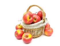 Ripe apples in a basket on a white background closeup Royalty Free Stock Photo