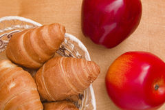 Ripe apples and croissants Royalty Free Stock Photography