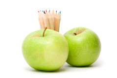 Ripe apples fruit and color pencils Royalty Free Stock Photos