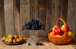 Ripe apples, grapes and figs. On a wooden table Royalty Free Stock Photography