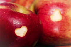 Ripe apples with hearts on wooden table, close-up. Healthy eatin Stock Photography