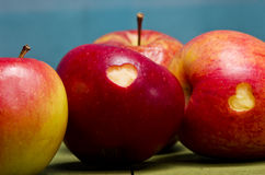Ripe apples with hearts on wooden table, close-up. Healthy eatin Royalty Free Stock Photography