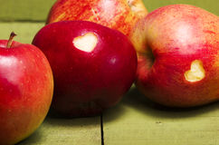 Ripe apples with hearts on wooden table, close-up. Healthy eatin Royalty Free Stock Image