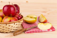 Ripe apples with knife on wooden table. Royalty Free Stock Images