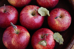 Ripe apples in rustic wooden bowl Stock Photos