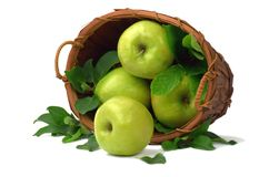 Ripe apples are scattered out of the basket. Isolated on white. royalty free stock images