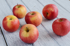 Ripe apples on shabby wooden table Royalty Free Stock Image