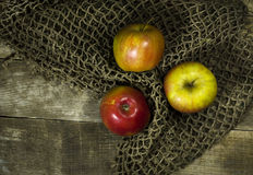 Ripe apples on a wooden background. With a grid royalty free stock photography