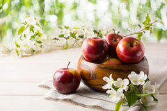 Ripe apples in wooden bowl Stock Photo