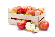 Ripe apples in wooden carte Stock Images