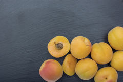 Ripe apricot on black background of slate or stone Royalty Free Stock Photo