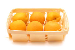 Ripe apricots. In a basket isolated on white background Stock Image
