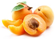 Ripe apricots with apricot leaf isolated on the white background.  Royalty Free Stock Photo