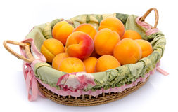 Ripe apricots in a basket Royalty Free Stock Images