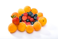 Ripe apricots and berries of strawberry, raspberry Stock Image