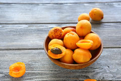 Ripe apricots in bowl Stock Images