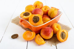 Ripe apricots in a ceramic bowl Stock Image