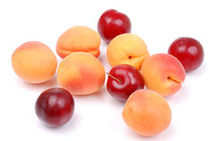 Ripe apricots and plums on white Royalty Free Stock Images