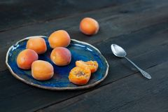 Ripe apricots on vintage blu plate stock photography