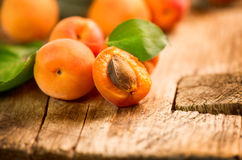 Ripe apricots on a wooden background Royalty Free Stock Photos