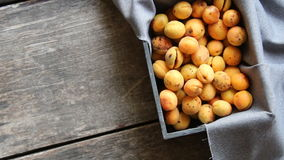 Ripe apricots in wooden box. Food background. stock video footage