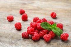 Ripe raspberries on wooden table. Ripe aromatic raspberries on wooden table Royalty Free Stock Photography