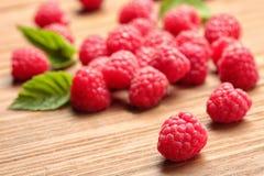 Ripe raspberries on wooden table. Ripe aromatic raspberries on wooden table Royalty Free Stock Image
