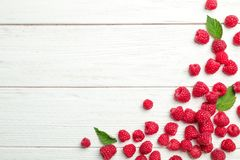 Ripe aromatic raspberries on wooden table. Top view Royalty Free Stock Photos