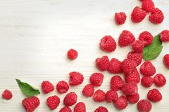 Ripe raspberries on wooden table, top view. Ripe aromatic raspberries on wooden table, top view Stock Photo