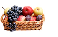 Ripe autumn fruits at the wooden basket. Stock Images