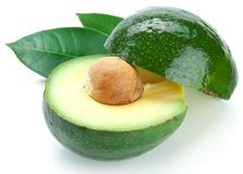 Ripe avacados with leaves. Royalty Free Stock Images