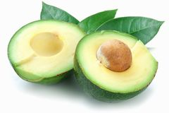 Ripe avacados with leaves. stock images