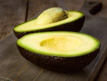 Ripe avocado. Cut in half royalty free stock image