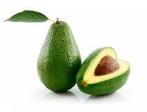 Ripe Avocado With Green Leaf Isolated on White. Background Royalty Free Stock Image