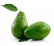 Ripe Avocado With Green Leaf Isolated on White Royalty Free Stock Photography