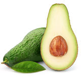 Ripe avocado with green leaf Royalty Free Stock Images