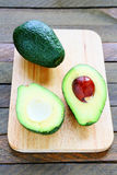 Ripe avocado on wooden board stock images