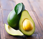 Ripe avocado on a wooden. Stock Images