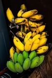 Ripe banana that are both green and yellow. stock photography