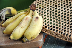 Ripe banana on cutting board Stock Images