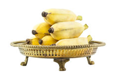 Ripe banana put on brass tray Stock Images