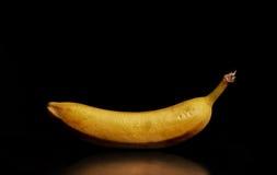 Ripe banana. Side view of ripe banana on dark studio background Stock Photography