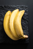 Ripe Bananas on a Black Stone Plate Stock Image