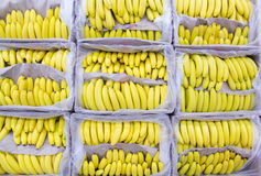 Ripe bananas in a box at the store. Royalty Free Stock Photo