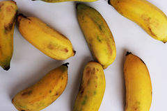 Ripe bananas are cut together in a yellow background.  Royalty Free Stock Photos