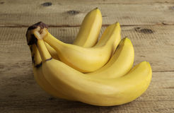 Ripe bananas on old wooden boards. Ripe yellow bananas on old wooden boards Royalty Free Stock Image