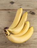 Ripe bananas on old wooden boards Royalty Free Stock Photo