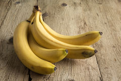 Ripe bananas on old wooden boards Royalty Free Stock Photos