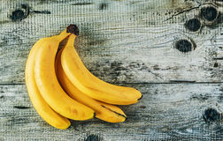 Ripe bananas on old wooden boards Stock Photography