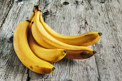 Ripe bananas on old wooden Stock Photos